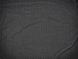 lapp av grått tyg för bakgrund eller konsistens foto