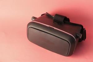 närbild av vr headset på rosa bakgrund foto