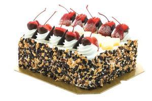 glasskaka med körsbär på toppen foto