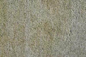 vintage vägg av granit sten texturerat bakgrund foto