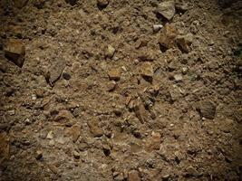 lapp av stenig jord eller sand för bakgrund eller konsistens