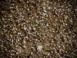 lapp av stenig jord eller sand för bakgrund eller konsistens foto