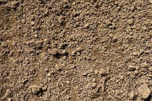 bakgrundsstruktur från den släta ytan på jordjord foto