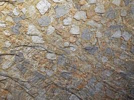 närbild av marmor eller stenvägg för bakgrund eller konsistens foto