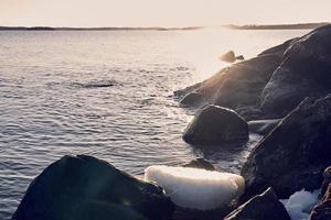 Östersjön vid solnedgången foto
