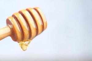färsk honung skopa foto