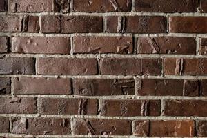 gammal brun tegelvägg, bakgrund, textur. bakgrund för skärmsläckare. foto