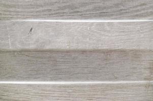 träfärgad porslinsstruktur med ojämn lättnad foto