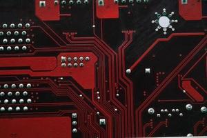 röda dator moderkort chips närbild med kontakter foto