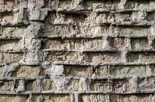 texturmönster av gammal förstörd tegelvägg, detaljerad bakgrundsbild på nära håll foto