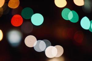 färgglada bokehljus på natten foto