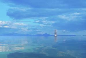 marinmålning med en vacker segelbåt i horisonten. foto
