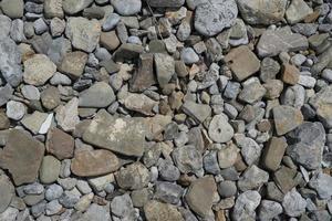 naturlig bakgrund av stenar i olika storlekar av grå. foto