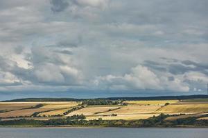 marinmålning och landskap av Invergordon i Skottland Storbritannien foto