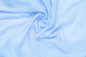 delikat mjukt och skrynkligt blått tyg foto
