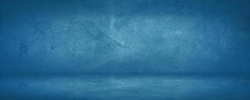 mörk och blå konkret och cementvägg och studio för att presentera produkt och bakgrund foto