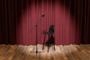 mikrofon och pall på en scen med gardiner bakom foto