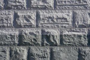 väggen av granitblock är som en bakgrund foto