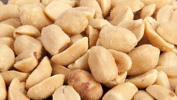 bearbetade ärter nötter bakgrund foto