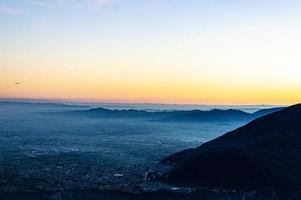 solnedgång bakom summano foto