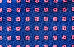 solid bakgrund av blått tyg med ett texturmönster foto