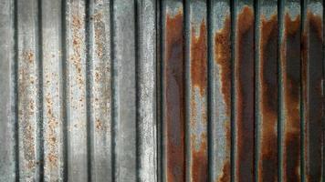 gammal rostig zinkväggtextur och bakgrund foto