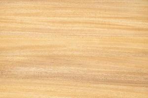 ovanifrån av ljus träbord med naturligt mönster och färg slätt trä abstrakt bakgrund foto