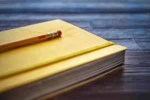 skissbok och penna foto