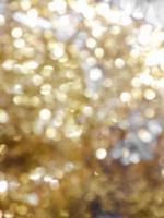 gyllene bokeh på en ofokuserad glitter foto