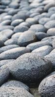 abstrakta släta runda stenar havet sten textur bakgrund foto