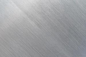 repad metall konsistens, borstad stålplåt bakgrund foto