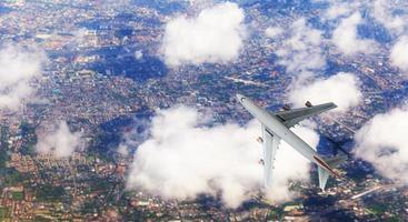 Flygfoto ovanifrån av flygplanet flyger över staden, vy från ovan foto