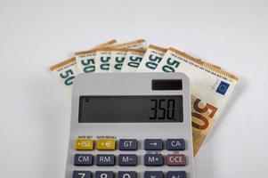 50 eurosedlar med miniräknare foto