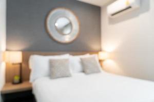 abstrakt oskärpa vackra lyxhotell sovrum foto