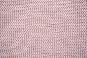 rosa stickad konsistens för bakgrund. merinogarn. foto