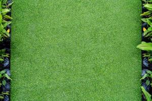 ovanifrån foto, konstgjord grönt gräs textur bakgrund foto
