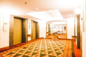 abstrakt oskärpa och defokuserat lyxhotell och lobbyinredning foto