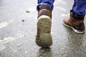 stövel med lera foto