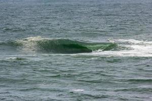 vinka på vidigal beach, känd som sheratonplatta i Rio de Janeiro foto