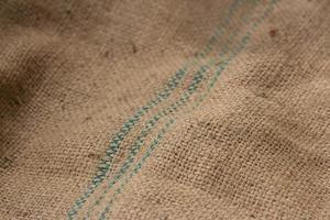 hessian säckväv säckväv vävd textur bakgrund. selektivt fokus foto