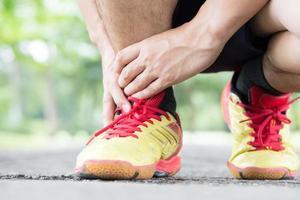archillis tendinit, skada som uppstått under träning och löpning foto