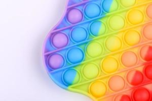 ljusa färgglada barnleksaker gjorda av silikon för att lindra stress foto