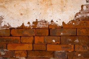 gammal grungy bakgrund för betongtextur för tegelstenvägg foto