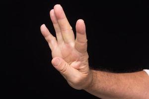 finger tecken på en vuxen man foto