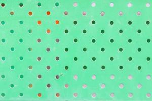 konsistens av smutsig grön metall med hål foto