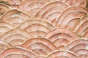 närbild mönster av grungy vägg formad som skalor av fisk foto
