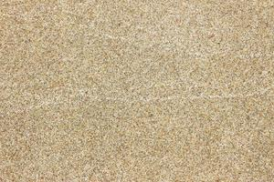 sand textur bakgrund på stranden foto