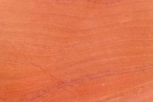 grov röd sten textur bakgrund. foto
