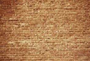 grunge brun tegelvägg bakgrund. åldrad konsistens foto