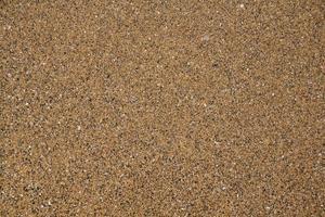 sandstruktur. sand bakgrund. Strand sand. toppvy foto